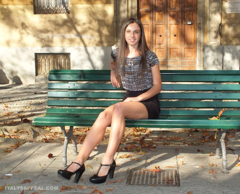 italian girl on a green bench