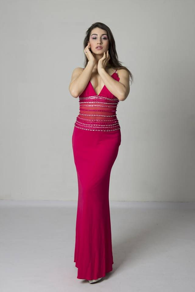 Valentina posing in the studio in a red dress. Italian girls images