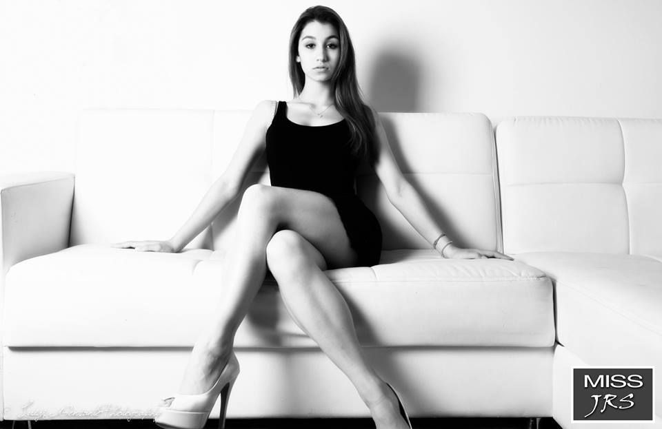 Valentina posing in the studio in a black and white photo. Italian girls with high heels pics