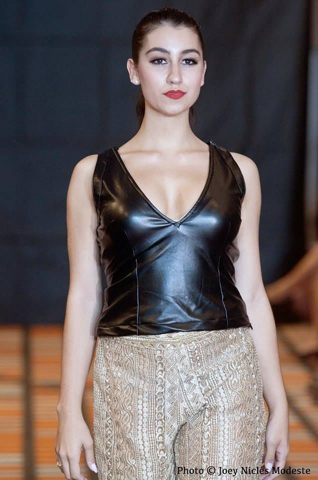 Valentina Italian girl with a fair complexion and dark hair while walking on the runway