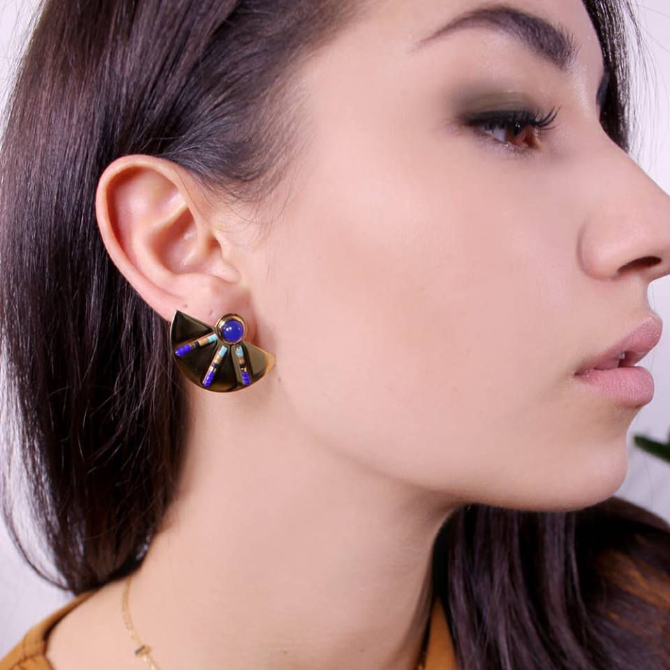 Italian model wearing a necklace and earring. Valentina's close-up. Italian girls pictures