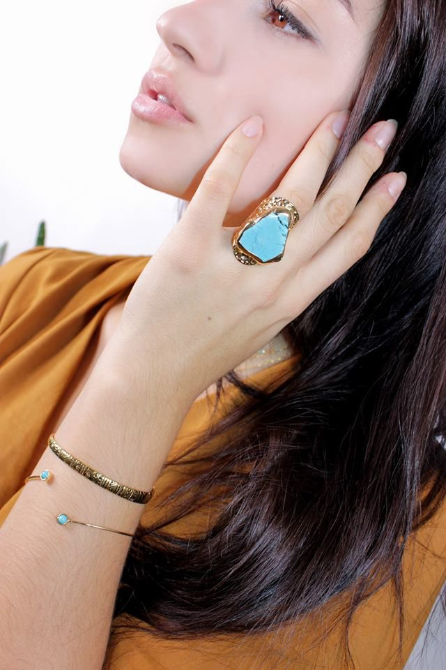 Italian model wearing a turquoise ring. Italian girls with black hair photos