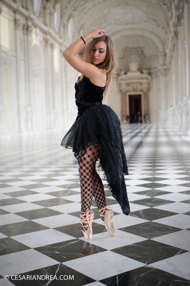 italian girl in a black classice dance outfit