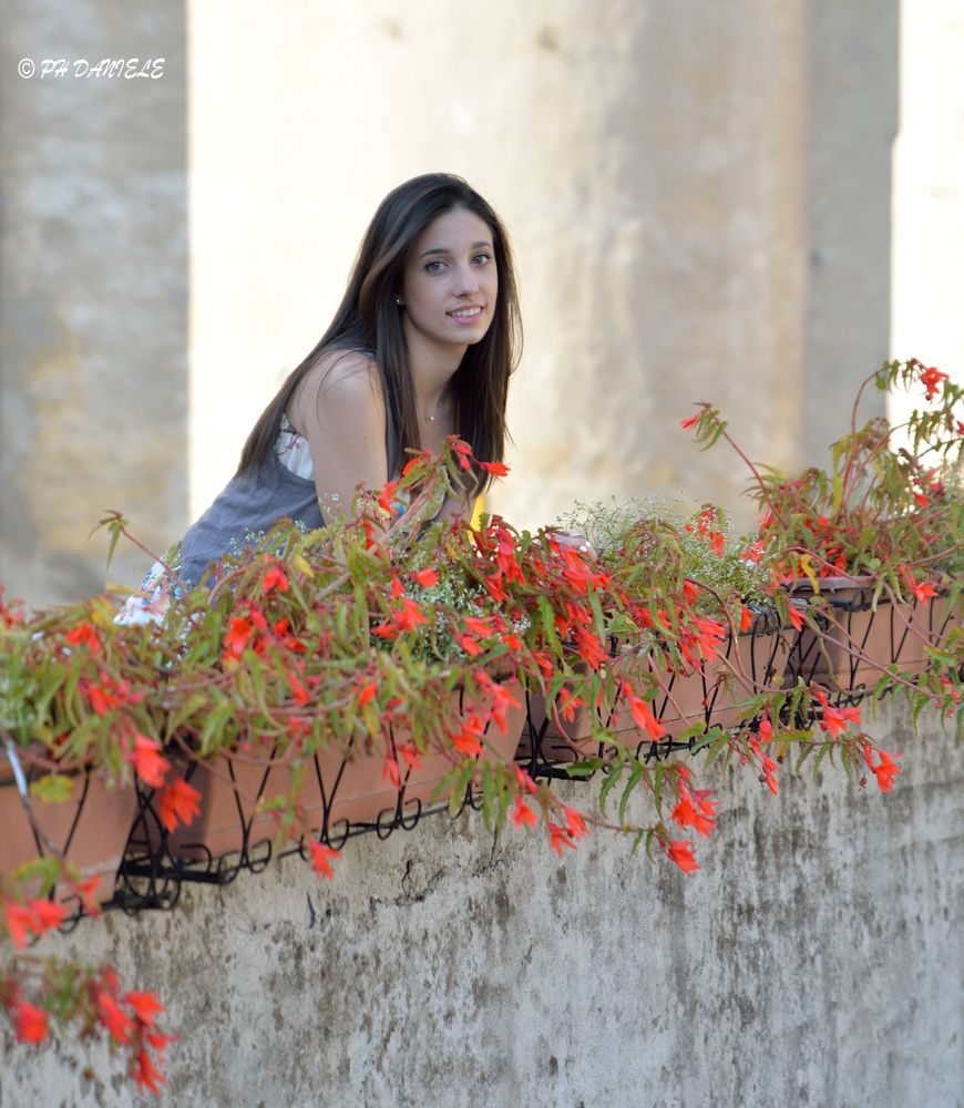 pretty italian girl and red flowers