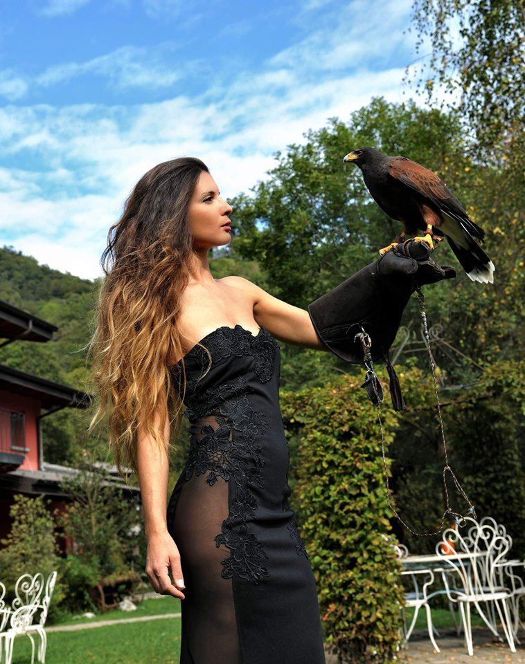 Roberta with a bird in the nature, Italy