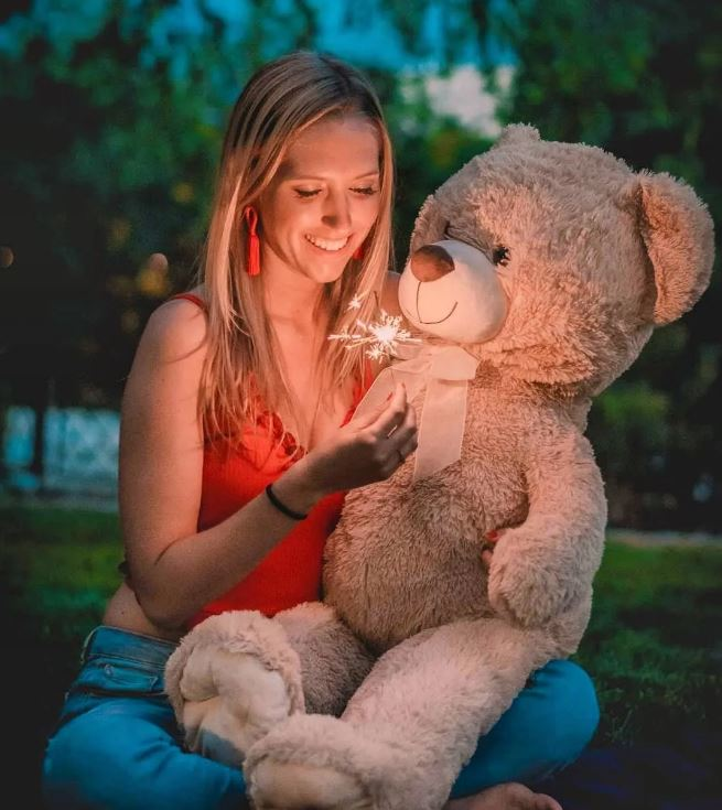 Italian girl with a plushie in the hands